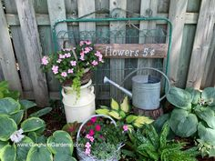 An old gate and vintage milk can used in an adorable garden vignette. Plus, more ideas for using upcycled vintage items as decor in the garden. #fleamarketgardening #ginghamgardens Rustic Garden Decor, Vintage Garden Decor, Rustic Gardens, Outdoor Gardens, Outdoor Cats, Garden Decorations, Garden Projects, Garden Crafts, Outdoor Projects