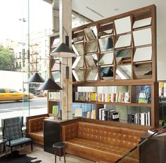 THE NOLITAN HOTEL, NEW YORK- by Grzywinski+Pons.  The opulent interiors are fit out with retro furniture and fittings, mixed with contemporary pieces. Interesting details like the unusual bookshelf with tilting mirrors give the living spaces a cool, edgy feel.