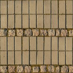 Seamless pavement texture consisting of beige bricks of different types laid in…