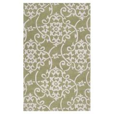 Hand-tufted rug with a scrolling medallion motif.   Product: Rug   Construction Material: 100% Polyester   Color: Turtle green and white     Features: Hand-tufted   Hand-carved details         Note: Please be aware that actual colors may vary from those shown on your screen. Accent rugs may also not show the entire pattern that the corresponding area rugs have.  Cleaning and Care: Blot stains