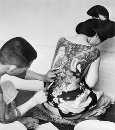 Tattooing has been practiced in Japan - for beautification, magic, and to mark criminals, since the fifth century B.C. Restricted from wearing kimonos usually worn by royalty & the elite, lower class women rebelled by wearing tattooed body suits, covering their torsos with illustrations that began at the neck & extended to the elbow & above the knee. Wearers hid the intricate designs beneath their clothing. It was these repressive laws that gave rise to the ornate Japanese designs known…