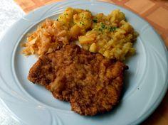 Cotlet de porc pané cu garnitură de cartofi la cuptor