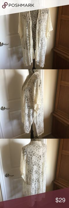 Cream Lace Kimono Jacket Open cascade style Lace jacket with dolman sleeve and open sides. Stretchy Lace and soft. Great over a simple top and jeans. NEW with tags. Jackets & Coats