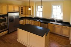 #Kitchen Idea of the Day: Light cabinets with black countertops.