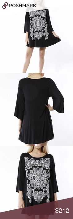 Lovely Black tunic top NEW!  Black tunic top or little mini dress. Goregous white pattern on front. comfortable and easy to wear. Material is 95% RAYON 5% SPANDEX HVHOUSEWIFE Tops Tunics