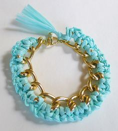 The DIY Raffia Bracelet upcycles a simple chain bracelet by crocheting raffia into the links! Add a pop of color to your chain with this free crochet jewelry pattern.