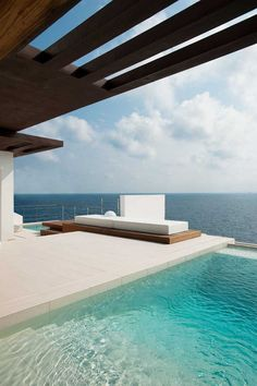 Juma Architects designed this luxurious home with a straight contemporary architecture and stunning sea views. The beautiful white villa is located on Ibiza (Spain) directly at seaside and it provides generous space and a big terrace with a pool. Amazing Swimming Pools, Cool Pools, Moderne Pools, Piscina Interior, Dream Pools, Spanish House, Spanish Style, Architect Design, Pool Designs