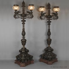 A Rare and Monumental Pair of Four Highly Important Bronze Torchères possibly by Gagneau Frères.These exceptional torchères are demonstrative of the highest quality work produced in Paris during the second half of the nineteenth century. The form of the scrolled arms corresponds closely to a lamp shown at the 1851 Exhibition in London by the Paris firm of 'Gagneau Frères'. The evident quality and exceptional size of these torchères would suggest a distinguished provenance. It is reputed…