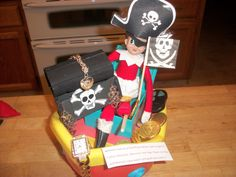 Elf of the Shelf Becomes a Pirate Our elf Lisa was up to mischief tonight, she is a pirate complete with wooden leg, eye patch, hat, pirate treasure chest, flag and boat.