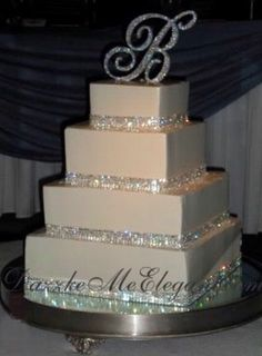I want the little bride and groom on top of our cake that look like us, but this letter idea would be good for other places in the wedding/reception!