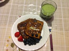Pumpkin French Toast with strawberries and blueberries drizzled with light organic honey. And of course, a mean green smoothie!
