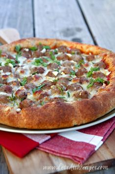 A hearty pizza loaded with meatballs and mozzarella cheese.
