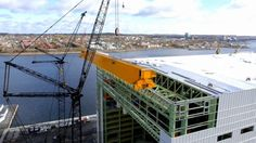 On November 4, 2014, another milestone for Irving Shipbuilding's Ultra Hall Production Building under construction at Halifax Shipyard. Video cameras captured the first day of the installation of two new bridge cranes which will be used to lift large blocks and mega modules during ship assembly. Each crane will lift up to 200 tonnes. This is another step in building the most modern shipyard in North America, part of Irving Shipbuilding's $300M plus investment to build Canada's new Naval ...