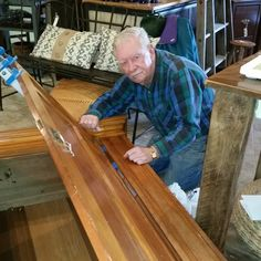 Terry Brand - master wood craftsman at work fixing an antique coat closet
