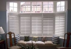 2/3 height white shutter blinds for bay window seat