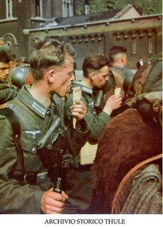 German soldiers enjoying ice cream cones in occupied Paris. -