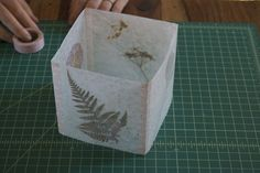 Lanterns made with pressed leaves and wax paper.