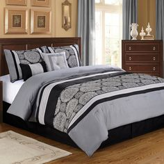 @Overstock - Grayson 6-piece Comforter Set - Enhance your bedroom decor with the modern Grayson 6-piece comforter set. Jacquard woven medallions on a steel grey background are pieced on the face of the comforter and shams, with brushed micro denier, for an architectural look.  http://www.overstock.com/Bedding-Bath/Grayson-6-piece-Comforter-Set/8609696/product.html?CID=214117 $114.99