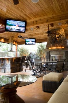 Custom designed and built rustic patio cover, ledgestone fireplace and kitchen, and acid stained concrete.