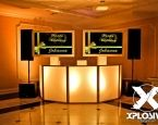 Just like the perfect present, this tv has a classy, elegant, and pretty custom screen saver to match this party aesthetic. #XplosiveEntertainment, #golduplighting, #LEDDJboothsetup, #partyentertainment.
