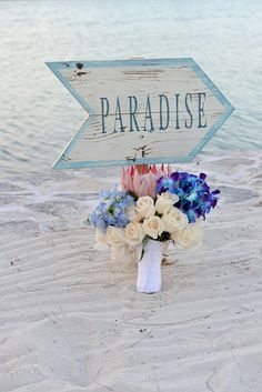Chic Bahamas Weddings | Exuma Wedding Planners.  Elegant purple, pink, blue tropical wedding bouquet. Turquoise Cay Boutique Hotel.  Photo by | Donna Von Bruening.
