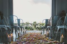 We just love how this couple used multi-coloured petals and candles to line the aisle.