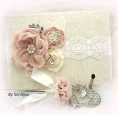 ***Made Upon Request- This set can be made in ANY color scheme This is another one of my decadent guest book and pen set. A gorgeous combination of blush pink, champagne, nude and ivory. The book has been covered with the finest linen (feels like silk to the touch) and a gorgeous lace in
