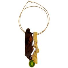 Thierry Vendome Peridot Diamond Decorative Metal Yellow Gold Pendant Necklace   From a unique collection of vintage necklace enhancers at http://www.1stdibs.com/jewelry/necklaces/necklace-enhancers/