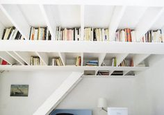 A book attic hidden above your head, for dinky London flats, perfect.