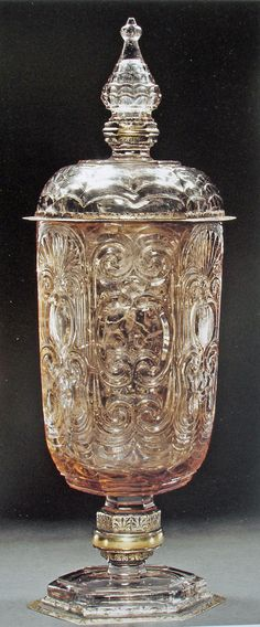 The hexagonal trophy cup with cover by Ferdinand Eusebio Miseroni in smoky quartz with gilded silver setting ( 51cm high, 15cm wide and 12cm deep). The foot and the cover is made in another piece of clear quartz and the black decoration of the gilded silver is only painted on and not anymore enamel based, as were those of his father
