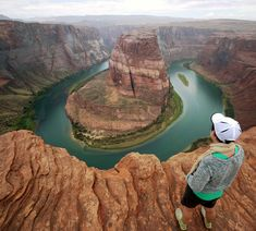 The Colorado River flows far through the famous Horseshoe Bend in Page, Arizona.  Mikel Ortega / Moment / Getty Images. #BestintheUS #LonelyPlanet