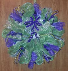 Green and purple mesh Christmas wreath with gold/purple mesh tubing.