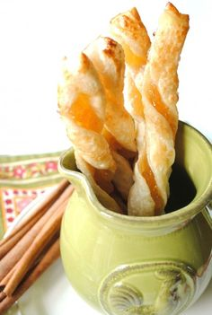 Apple cinnamon puff pastry twists. Recipes that are yummy and involve five ingredients or less rule in my world! This one starts with frozen puff pastry and includes prepared apple cinnamon jam. Any chunky jam would be delicious in this recipe - strawberry, apricot, even orange marmalade. But you can't beat the combination of apple and cinnamon for fall treats. Perfect for Thanksgiving and Christmas entertaining.
