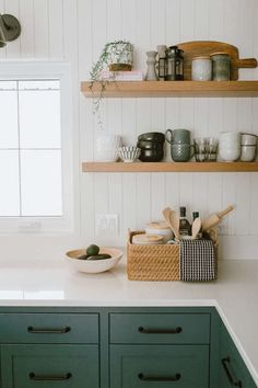 lovely farmhouse kitchen by Jaclyn Peters Design. The unusual grey green cabinets, vertical shiplap walls, the warm wood accents especially at the end of the island, the wide white oak floorboards and black accents. Green Kitchen Cabinets, New Kitchen, Kitchen Ideas, Ship Lap Kitchen, Vintage Kitchen, Green Kitchen Island, Kitchen Grey, Basement Kitchen, Kitchen Updates