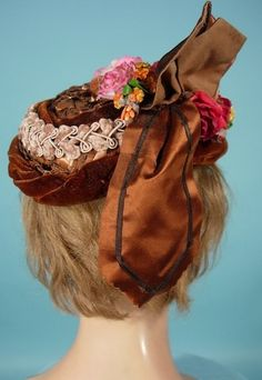 """1870's ____ Dark Straw Toque Hat with Velvet and Chenille Trim ____ The """"pork pie"""" shaped toque hat first became fashionable in the late 1860s, and then into the 1870's where they got slightly larger. ____ Photo 2"""