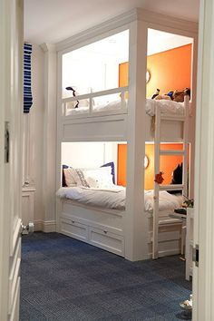 Clean white painted bunk beds with a punch of orange and navy - Tween/Teen Bunk Beds & Built-Ins