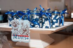Tiny jars of candy or mints