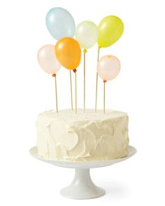 Balloon Cake Toppers | Martha Stewart Living - Swap out candles on your cake for mini balloons on sticks that make for adorable cake toppers, and cute party favors once the cake has been sliced.