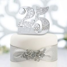 Anniversary Cake Pick-Mark the occasion with this anniversary cake pick. This cake pick, specially made for a anniversary, measures 4 x and is made of resin. The number 25 filled with floral grooves and sparkling rhinestones will 25th Anniversary Wishes, 25th Wedding Anniversary Cakes, Silver Anniversary, Anniversary Parties, Anniversary Decorations, Anniversary Ideas, Wedding Cake Toppers, Wedding Cakes, Lillian Rose
