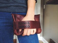 the half moon clutch in brown // hand-sewn brown buffed oiled kodiak leather clutch // hand strap with a push through button fastener (60.00 USD) by HUSTLEANDHIDE