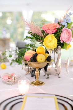 Pink, yellow, and blue tabletop with fruit