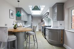 open galley kitchen Lewis Alderson & Co, Tadley Kitchen. An extension provides the beautiful galley kitchen in this 4 bedroom house with feature glazed domed ceiling which floods the room with natural light. Kitchen Corner, New Kitchen, Narrow Kitchen Island, Galley Kitchen Design, Open Plan Kitchen Living Room, Breakfast Bar Kitchen, Home Kitchens, Galley Kitchens, Houzz