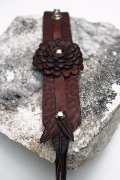 Button Pom Pom Leather Cuff in Cognac Aztec Leather - Part of the Rosa Collection of Leather Accessories. $124.50, via Etsy.