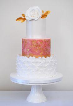Pink painted tier, white heart petal ruffles and sugar white rose wedding cake