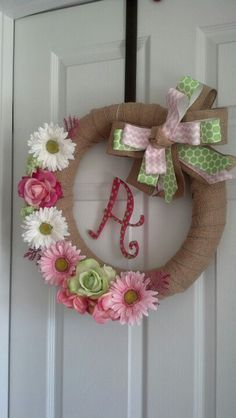 POOL NOODLE wreath! I found a pin suggested making a wreath form out of a pool noodle! Genius! My pool noodle was $1! The foam wreath form was $8! So I cut it to the size I wanted then secured it with masking tape. After that, I wrapped it with burlap ribbon and then attached my flowers with hot glue, painted my monogram, and made my bow.