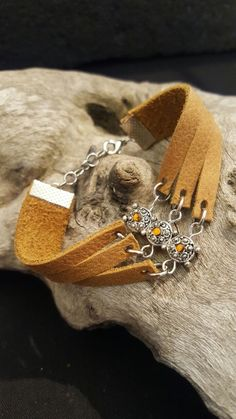 L111 R80.00  tan genuine leather bracelet strap cut with 3 strips and and charm with tan bling whale clasp and extension chain fits 15-17cm See related items on Fanatic Leather Store.