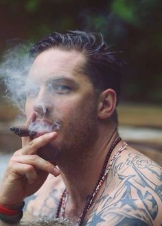 Tom Hardy, looking dead on at the camera. Those eyes, whoaaa...TOM STOP IT> tee hee.