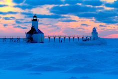 From USA Today - St. Joe's lighthouse in Saugatuck, Mich., stands watch over the frozen, snow-covered waters of Lake Michigan on a frigid day in 2014