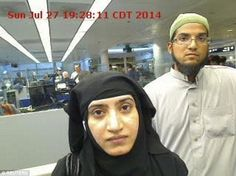 Malik and husband Syed Farook (pictured arriving at Chicago's O'Hare International Airport in July 2014) killed 14 people in San Bernardino earlier this month