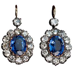 Antique Russian Sapphire Diamond Earrings A pair of sapphire and diamond cluster earrings, circa 1915, crafted in silver and 14K rose gold. 26 old European diamonds have an estimated total weight of 3 carats. Appoximate total weight of the sapphires - 4.32 ct. Original velvet case.  Marked with later Soviet control hallmarks from the late 1920s-early 1930s.